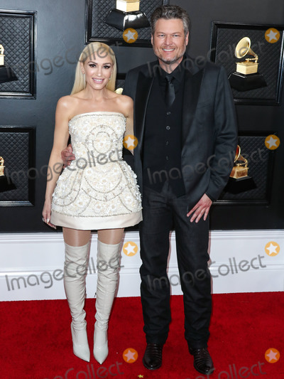 Blake Shelton, Dolce and Gabbana, Gwen Stefani, Grammy Awards Photo - (FILE) Gwen Stefani's Las Vegas Residency Dates for May Are Canceled Amid Coronavirus COVID-19 Pandemic. Gwen Stefani has announced that all of her 'Just a Girl' concerts scheduled for May 2020 have been canceled because of the health crisis. LOS ANGELES, CALIFORNIA, USA - JANUARY 26: Singer Gwen Stefani (wearing Dolce and Gabbana with Mateo jewelry) and partner/singer Blake Shelton arrive at the 62nd Annual GRAMMY Awards held at Staples Center on January 26, 2020 in Los Angeles, California, United States. (Photo by Xavier Collin/Image Press Agency)