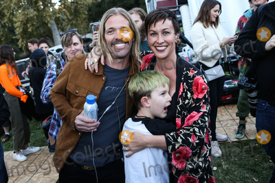 Alanis Morissette, Taylor Hawkins Photo - CALABASAS, LOS ANGELES, CA, USA - DECEMBER 02: Taylor Hawkins, Alanis Morissette and Ever Imre Morissette-Treadway at the One Love Malibu Festival Benefit Concert For Woolsey Fire Recovery held at the King Gillette Ranch on December 2, 2018 in Calabasas, Los Angeles, California, United States. (Photo by Xavier Collin/Image Press Agency)
