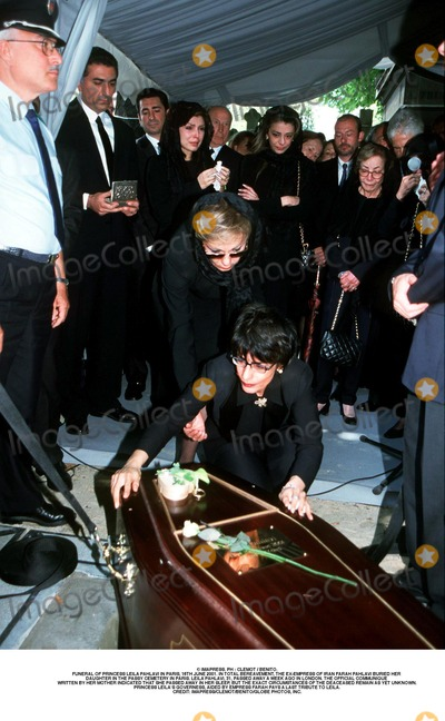 Farah Pahlavi, Passy, As Yet Photo - IMAPRESS. PH : CLEMOT / BENITO.FUNERAL OF PRINCESS LEILA PAHLAVI IN PARIS, 16TH JUNE 2001. IN TOTAL BEREAVEMENT, THE EX-EMPRESS OF IRAN FARAH PAHLAVI BURIED HER DAUGHTER IN THE PASSY CEMETERY IN PARIS. LEILA PAHLAVI, 31, PASSED AWAY A WEEK AGO IN LONDON. THE OFFICIAL COMMUNIQUE WRITTEN BY HER MOTHER INDICATED THAT SHE PASSED AWAY IN HER SLEEP, BUT THE EXACT CIRCUMSTANCES OF THE DEACEASED REMAIN AS YET UNKNOWN.PRINCESS LEILA'S GOVERNESS, AIDED BY EMPRESS FARAH PAYS A LAST TRIBUTE TO LEILA.CREDIT: IMAPRESS/CLEMOT/BENITO/GLOBE PHOTOS, INC.