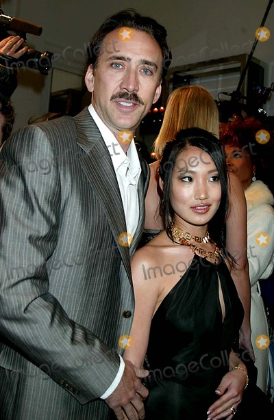 Nicolas Cage, Alice Kim, Donatella Versace, Nicolas Cazalé Photo - Donatella Versace Host Cocktail Party to Celebrate the Re-opening of the Versace Boutique on Fifth Avenue , New York City. 02-07-2006 Photo: Sonia Moskowitz-Globe Photos Inc. 2006 Nicolas Cage Alice Kim
