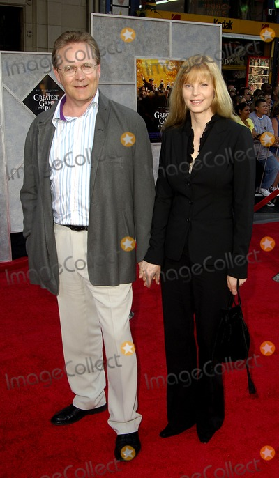 Mark Frost, Walt Disney Photo - Screenwriter for the film, Mark Frost and his wife Lynn pose for photographers, during the premiere of the new movie from Walt Disney Pictures, THE GREATEST GAME EVER PLAYED, held at the El Capitan Theater, on September 25, 2005, in Los Angeles. 