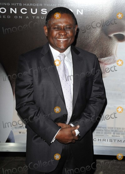 """Bennet Omalu Photo - Bennet Omalu attending the Los Angeles Premiere of """"Concussion"""" Held at the Regency Village Theater in Westwood, California on November 23, 2015 Photo by: David Longendyke-Globe Photos Inc."""