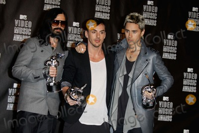 """Jared Leto, Tomo Milicevic, 30 Seconds to Mars Photo - Musicians Tomo Milicevic , Shannon and Jared Leto of """"30 Seconds to Mars"""" the """"2010 Mtv Video Music Awards"""" (Pressroom) Held at the Nokia Theatre, Los Angeles, California 09-12-2010 Photo by Alec Michael-Globe Photos, Inc. 2010"""