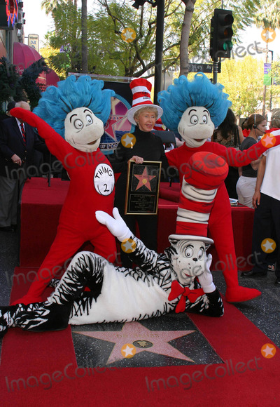 Audrey Geisel Photo - AUDREY GEISEL, THE WIFE OF AUTHOR DR. SEUSS (THEODOR GEISEL) POSED WITH CHARACTERS FROM CAT IN THE HAT AS DR SEUSS WAS HONORED POSTHUMOUSLY WITH THE 2249TH STAR -DR SEUSS HONORED WITH STAR ON THE HOLLYWOOD WALK OF FAME -HOLLYWOOD BOULEVARD, HOLLYWOOD, CA -03/11/2004 -PHOTO BY NINA PROMMER/GLOBE PHOTOS INC2004K36070NP