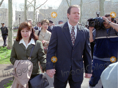 Abner Louima, Charles Schwarz, Neils Schneider, Police Officer, Alfonso André, Peter André Photo - 4/3/02_Brooklyn N.Y._Former NYC police officerCharles Schwarz, walks with wife Andra, after he was arraigned on perjury charges stemming from his trial & conviction of the torture of Haitiam immigrant Abner Louima in a Brooklyn police stationhouse bathroom.(PhotoNeil Schneider)GLOBE PHOTOS INC 2002K24719NSCH