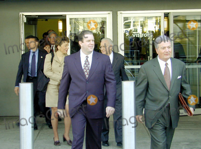 Abner Louima, Charles Schwarz, Neils Schneider, Police Officer, Alfonso André, Hüsker Dü, Peter André Photo - 4/3/02_Brooklyn N.Y._Former NYC police officerCharles Schwarz,(C) walks with attorney Ron Fischetti (R), after he was arraigned on perjury charges stemming from his trial & conviction of the torture of Haitiam immigrant Abner Louima in a Brooklyn police stationhouse bathroom.(PhotoNeil Schneider)GLOBE PHOTOS INC 2002K24719NSCH