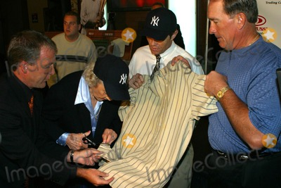 Babe Ruth Photo - Donruss Trading Cards to Unveil Plans For the 1925 Game Worn Babe Ruth Jersey New York City 10/20/2003 Photo by Rick Mackler/rangefinders/Globe Photos Inc Babe Ruth's Daughter Julia Ruth Stecens Cutting the Jersey
