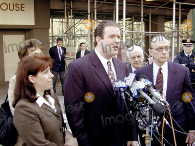 Abner Louima, Charles Schwarz, Neils Schneider, Police Officer, Alfonso André, Hüsker Dü, Peter André Photo - 4/3/02_Brooklyn N.Y._Former NYC police officerCharles Schwarz,(C) with wife Andra, (L)after he was arraigned on perjury charges stemming from his trial & conviction of the torture of Haitiam immigrant Abner Louima in a Brooklyn police stationhouse bathroom.(PhotoNeil Schneider)