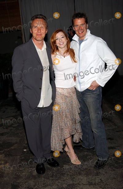 Alexis Denisof, Alyson Hannigan, Anthony Stewart Head, Slayer, Buffie Photo - . Party to Celebrate the Final Buffy the Vampire Slayer Series. at Miauhaus in Los Angeles, CA. 4/18/2003 . Photo by Fitzroy Barrett / Globe Photos Inc. 2003 Anthony Stewart Head with Alyson Hannigan and Her Fiance Alexis Denisof