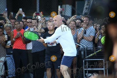 Andre Agassi Photo - Andre Agassi attends Nike NYC Street Tennis Event Washington Street, NYC August 24, 2015 Photos by Sonia Moskowitz, Globe Photos Inc