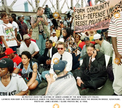 Abner Louima, The Beat Photo - In Protest Over the Beating of Abner Louima by the New York City Police. Laywers Ron Kuby & Peter Neufield Joined the Protesters As Thay Marched Over the Brooklyn Bridge. K20478jbe. James Bevins Globe Photos Inc. 1998.