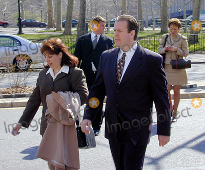 Abner Louima, Charles Schwarz, Neils Schneider, Police Officer, Alfonso André, Hüsker Dü, Peter André Photo - 4/3/02_Brooklyn N.Y._Former NYC police officerCharles Schwarz, walks with wife Andra,(foreground) after he was arraigned on perjury charges stemming from his trial & conviction of the torture of Haitiam immigrant Abner Louima in a Brooklyn police stationhouse bathroom.(PhotoNeil Schneider)