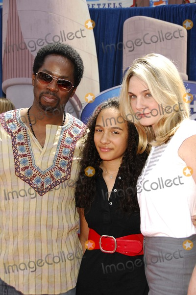 Harold Perrineau, Aurora, Walt Disney, Aurora Perrineau Photo - LOS ANGELES, CA MARCH 25, 2007 (SSI) - -Actor Harold Perrineau, his daughter Aurora Perrineau and his wife, actress Brittany Perrineau during the premiere of the new movie from Walt Disney Pictures MEET THE ROBINSONS, held at the El Capitan Theater, on March 25, 2007, in Los Angeles. PHOTO BY MICHAEL GERMANA-GLOBE PHOTOSK52331MGE
