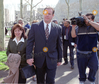 Abner Louima, Charles Schwarz, Neils Schneider, Police Officer Photo - 4/3/02_Brooklyn N.Y._Former NYC police officerCharles Schwarz, walks with wife Andra, after he was arraigned on perjury charges stemming from his trial & conviction of the torture of Haitiam immigrant Abner Louima in a Brooklyn police stationhouse bathroom.(PhotoNeil Schneider)