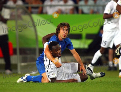 Andrea Pirlo, Michael Essien Photo - Italy Vs Ghana 06-12-2006 Hannover, Germany Photo by Richard Sellers-Globe Photos, Inc. 2006 Andrea Pirlo & Michael Essien Challenge