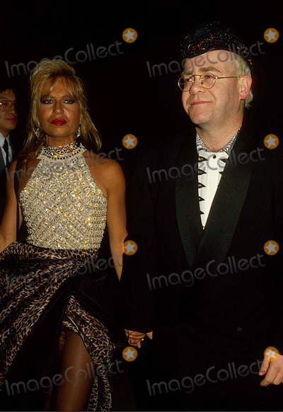 Elton John Photo - Elton John with Danatella Versace 1990 #15827 Photo by Phil Roach-ipol-Globe Photos, Inc.