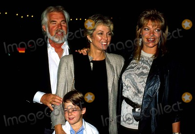 Kenny Rogers Photo - Kenny Rogers with His Wife Marianne Gordon , Son Christopher Cody Rogers and Daughter Carole Lynne 1987 #14504 Photo by Phil Roach-ipol-Globe Photos, Inc.
