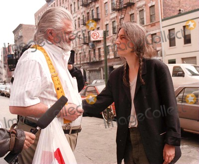 "Allen Ginsberg, Patti Smith, Patty Smith, PATTIE SMITH Photo - Patti Smith Leaves Allen Ginsberg's Apartment and Stops to Speak with Ginsberg's Longtime Companion and ""Wife"" Peter Orlovsay. Credit: Jennifer Weisbrod/Globe Photos, Inc."