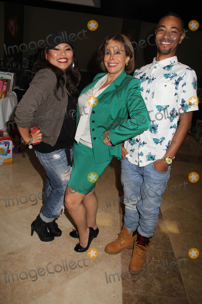 """Photo - """"Working Dreams"""" Annual Holiday Toy Drive Courtyard Marriott, Culver City, CA 12/22/2014 Josephine Roberto, Lola Levoy and Rey Reel Clinton H. Wallace/ipol/Globe Photos Inc"""