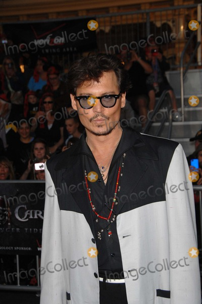 Johnny Depp, Walt Disney Photo - Johnny Depp During the Premiere of the New Movie From Walt Disney Pictures Pirates of the Caribbean: on Stranger Tides, Held at Disneyland, on May 7, 2011, in Anaheim, california.photo: Michael Germana  - Globe Photos, Inc. 2011