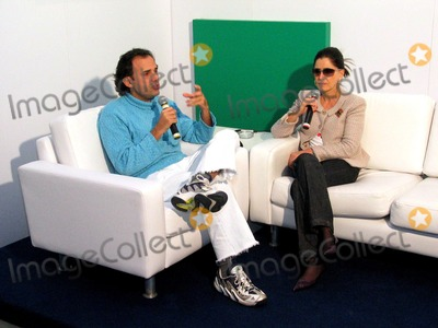Photo - : Sao Paulo, Brazil: Paulo Borges, Coordinator of the Event During an Interview with Brazilian Journaliste Gloria Kalil at the Backstage of Sao Paulo Fashion Week 2003. Photo: Cityfiles / Globe Photos, Inc
