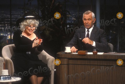 Johnny Carson, Dolly Parton Photo - Johnny Carson with Dolly Parton 1982 Photo by Allan S. Adler-Globe Photos, Inc.
