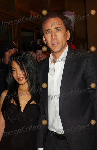 Alice Kim, Nicolas Cage, Alice Kim Cage Photo - Nicolas Cage and His Wife Alice Kim Cage Remiere of Ghost Rider at Regal E-walk in New York City on 02-15-2007 Photo by Ken Babolcsay-ipol-Globe Photos, Inc.
