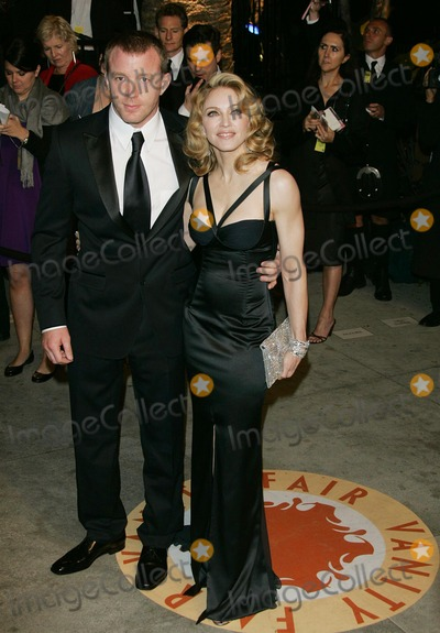 Guy Ritchie, Madonna Photo - Guy Ritchie & Madonna Actor & Actress/singer K51945 79th Annual Academy - Oscar Awards Vanity Fair Party at Morton's , Los Angeles CA. 02-25-2007 Photo by Graham Whitby-allstar-Globe Photos, Inc.