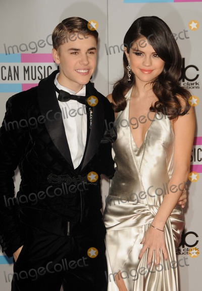 Gomez, Justin Bieber, Selena Gomez Photo - Justin Bieber, Selena Gomez attending the 2011 American Music Awards Arrivals Held at the Nokia Theatre in Los Angeles, California on 11/20/11 Photo by: D. Long- Globe Photos Inc.
