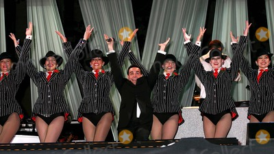 """Mario Cantone, The Radio City Rockettes Photo - the 4th Annual """" Broadway Under the Stars """" at Bryant Park in New York City 6-13-2005 Photo By:mitchell Levy-rangefinders-Globe Photos, Inc 2005 Mario Cantone and the the Radio City Rockettes"""