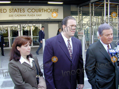 Abner Louima, Charles Schwarz, Neils Schneider, Police Officer, Alfonso André, Hüsker Dü, Peter André Photo - 4/3/02_Brooklyn N.Y._Former NYC police officerCharles Schwarz,(C) with wife Andra,(L) & attorney Ron Fischetti(R) after he was arraigned on perjury charges stemming from his trial & conviction of the torture of Haitiam immigrant Abner Louima in a Brooklyn police stationhouse bathroom.(PhotoNeil Schneider)