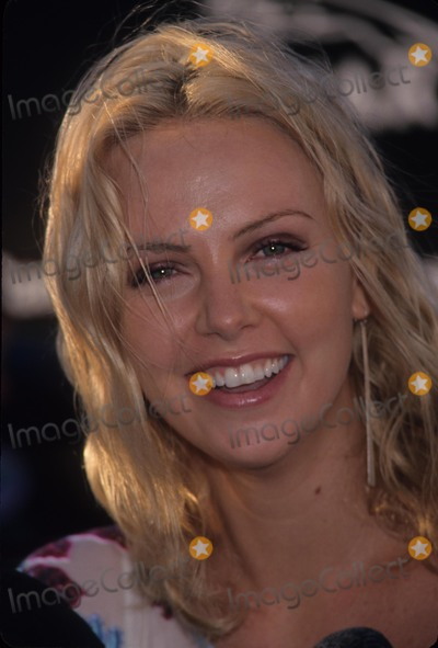 Andy Warhol, Charlize Theron Photo - Charlize Theron at Gala Opening of Andy Warhol Retro Museum of Contemporary Los Angeles Ca. 2002 K25111eg Photo by Ed Geller-Globe Photos, Inc.