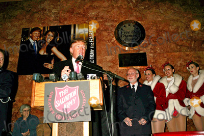 Donald Trump, The Radio City Rockettes Photo - Donald Trump and the Radio City Rockettes Hold Press Conference to Help the Salvation Army Campaign For Volunteers and Donations. Trump Tower, New York City 11-23-2004 Photo: Rick Mackler/rangefinders/Globe Photos Inc