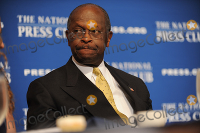 Photo - Herman Cain, Candidate For the Gop Presidential Nomination Speaks to Journalists About How He Would Do Things Should He Become President.
