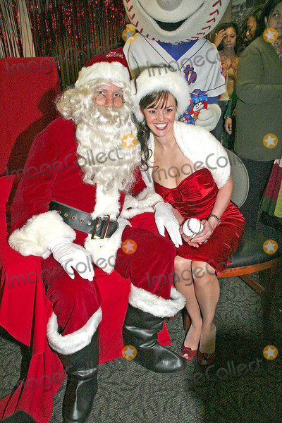 """ANNA BENSON Photo - /14/05 - Mets Host Annual Holiday Party For Local Children at Shea Stadium. Pictured Here Is Anna Benson Who Accompanied Her Husband Kris """"Santa"""" Benson and One of the Children. I10344bt Photo by Barry Talesnick-ipol-Globe Photos"""