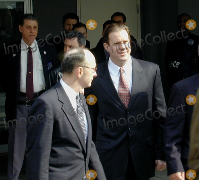 Abner Louima, Charles Schwarz, The Police, 702, Neils Schneider, Police Officer Photo - 3/7/02_Brooklyn New York_Former New York City police officer Charles Schwarz (R) outside the Federal Courthouse in Brooklyn, after being released on One million dollars bail in the police torture of Abner Louima. Schwarz was convicted of holding Louima down while police officer Justin Volpe sodimized Louima with a broom handle. Schwarz will face another jury in June.(PhotoNeil Schneider)