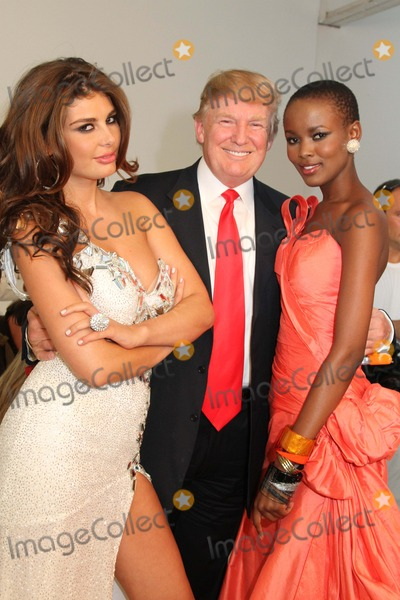 Donald Trump, Angela Martini, Queen, MISS UNIVERSE, Miss Albania, Flaviana Matata Photo - Donald Trump Poses with Famous Former Miss Universe Beauty Queens Chelsea Piers, Pier 59 Studios, NYC July 27, 2011 Photos by Sonia Moskowitz, Globe Photos Inc 2011 Angela Martini, Miss Albania 2010, Donald Trump, Flaviana Matata, Miss Tanzania