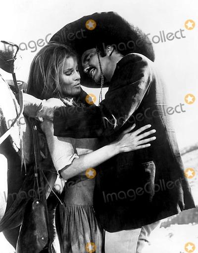 "Burt Reynolds, Raquel Welch Photo - Raquel Welch and Burt Reynolds in a Scene From ""100 Rifles"". Supplied by Smp/Globe Photos, Inc."