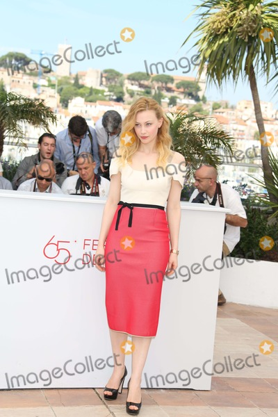 """Sarah Gadon Photo - Actress Sarah Gadon Poses at the Photocall of """"Cosmopolis"""" During the 65th Cannes Film Festival at Palais Des Festivals in Cannes, France, on 25 May 2012. Photo: Alec Michael Photo by Alec Michael-Globe Photos, Inc."""