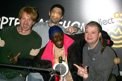 Flava, Flava Flav, Anthony Cumia, Jim Norton, Opie and Anthony, Group Shot Photo - Flava Flav with Opie Hughes on Xm Satellite Radio's Opie and Anthony at Xm's Studios in New York City on 02-10-2005 Photo: Rick Mackler-rangefinders-Globe Photos Inc. 2005 Flava Flav with Opie Hughes, Anthony Cumia and Jim Norton