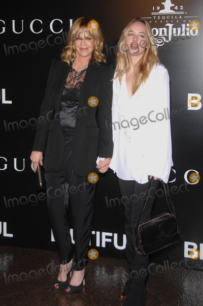 Melanie Griffith, Melanie Griffiths Photo - Melanie Griffith and Dakota Mayi Johnson During the Premiere of the New Movie From Roadside Attractions Biutiful, Held at the Directors Guild of America Theatre, on December 14, 2010, in Los Angeles , Ca. Photo by Michael Germana-Globe Photos, Inc.